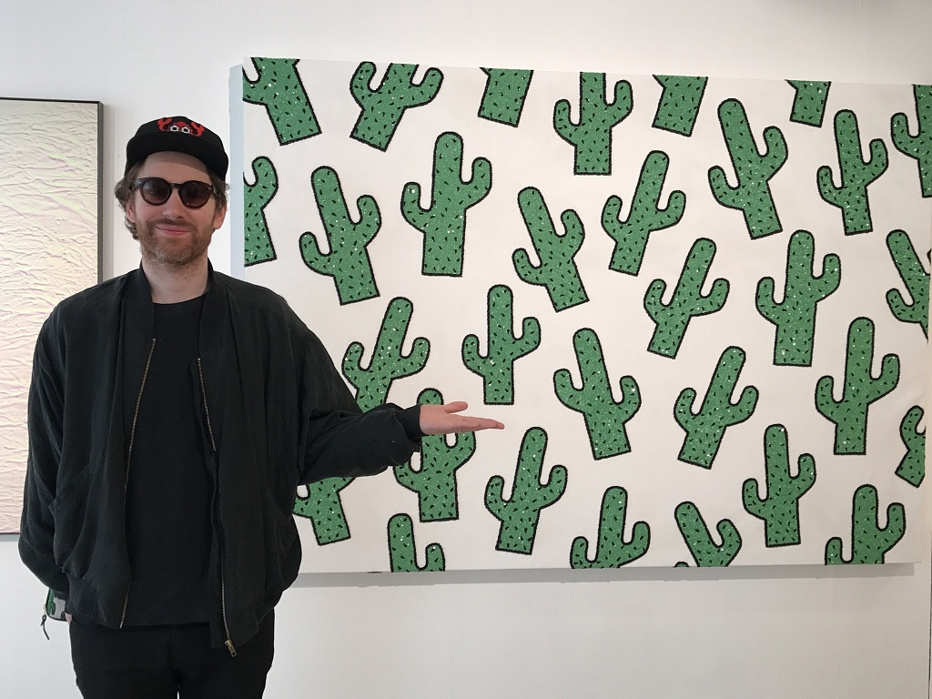 Philip Colbert with his artwork Cactus